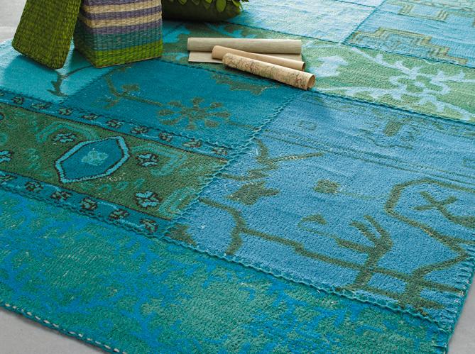 des tapis qui r chauffent le salon elle d coration. Black Bedroom Furniture Sets. Home Design Ideas